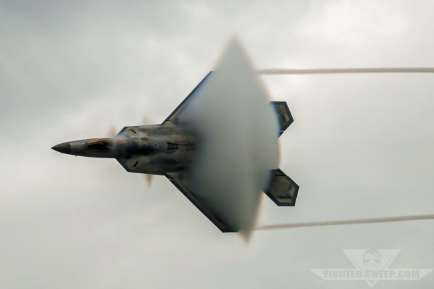 """Major David """"Zeke"""" Skalicky, F-22A Raptor Demonstration Team pilot, performs at an airshow in 2010."""
