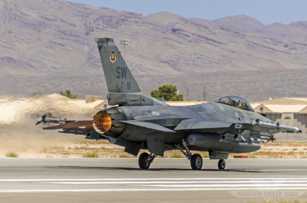 A Block 50 F-16CJ from the 55th Fighter Squadron, Shaw AFB, takes off with two laser-guided GBU-12s, en route to support an integration exercise at Fort Irwin, CA.