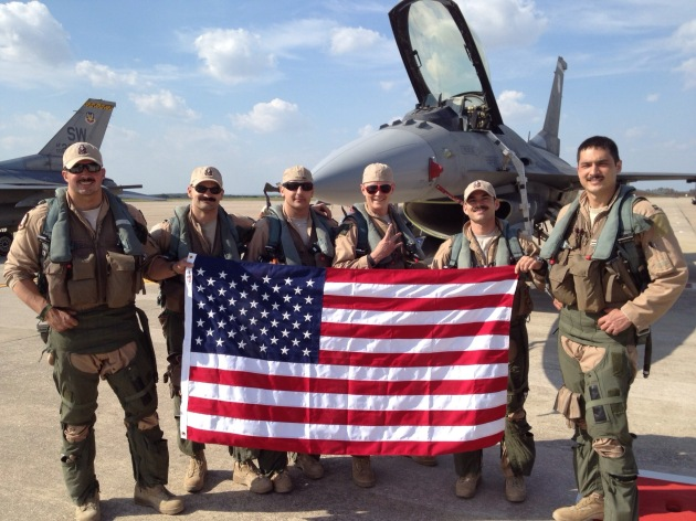 """""""Gamblers"""" pose in front of a Block 50 F-16CJ upon completing a successful mission in support of Operation Enduring Freedom. Led by Lieutenant Colonel Johnny """"Vegas"""" Vargas, the 77th FS flew more than 20,000 combat hours and dropped more than 1,000 munitions over a two-year period. (Photo courtesy of Major Mike """"Tazer"""" Chebino)"""