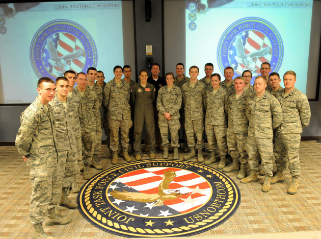 University of Tennessee Air Force Reserve Officer Training Corps cadets pose for a group photo during their visit to Joint Task Force Civil Support here March 20, 2014. More than 20 cadets received a mission brief and took a tour of the headquarters building as part of their spring 2014 Hampton Roads military base tour.  JTF-CS anticipates, plans and prepares for chemical, biological, radiological, and nuclear defense support of civil authority (CBRN-DSCA) response operations. When directed, JTF-CS deploys to command and control DOD forces in support of civil authority response operations in order to save lives, prevent further injury and provide temporary critical support to enable community recovery. (Official DOD photo by U.S. Navy Petty Officer 1st Class Brian Dietrick)