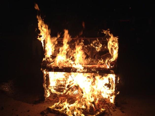 A piano burns at Kadena AB, Okinawa, courtesy of the 67 FS.