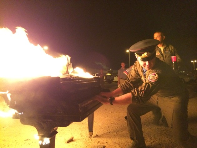 Members of the 65 AGRS burn a piano to mark the inactivation of the 65th Aggressor Squadron at Nellis AFB, Nevada.