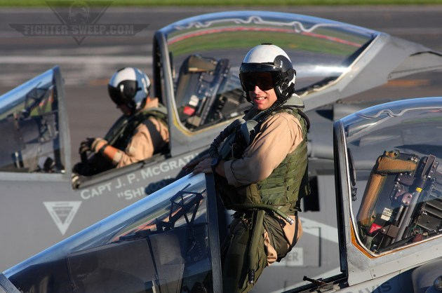 """A pair of VMA-223 """"Bulldogs"""" pilots strap on their jets prior to departing on a local mission"""