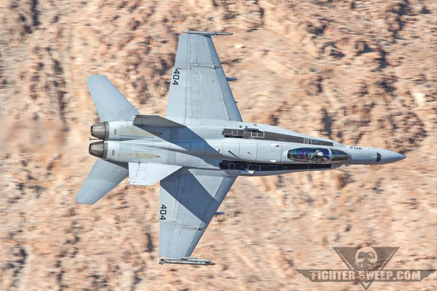 """Just prior to converting to Super Hornets, this C-model from VFA-192 the """"World Famous Golden Dragons"""" is descending through Star Wars Canyon on the Sidewinder Route in Death Valley, CA. SSHWFGD!"""