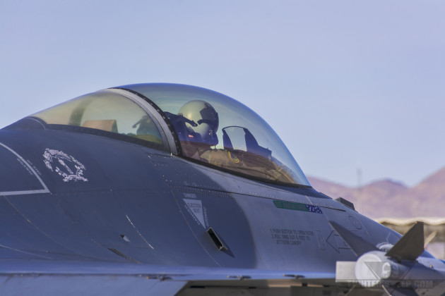 A pilot from the 134 FS, 158 FW taxis toward the runway during Red Flag 15-1, held at Nellis AFB, Nevada.