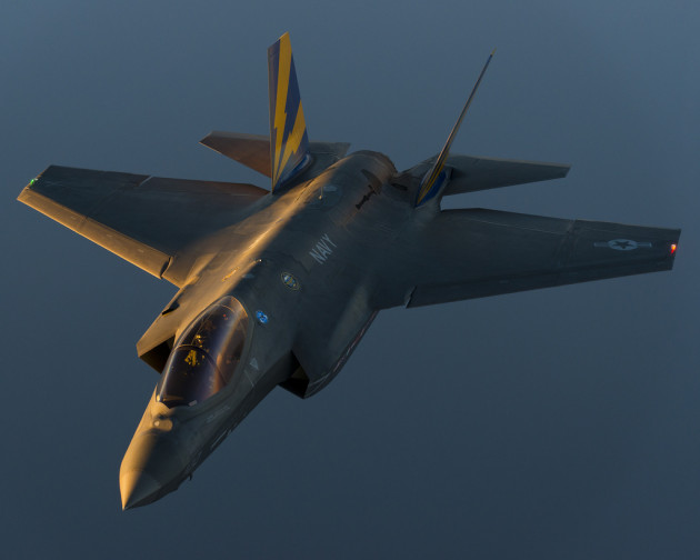 An F-35C test aircraft flies at dusk to prepare for a night refueling mission in September 2013. The flight originated from Naval Air Station Patuxent River, Md.