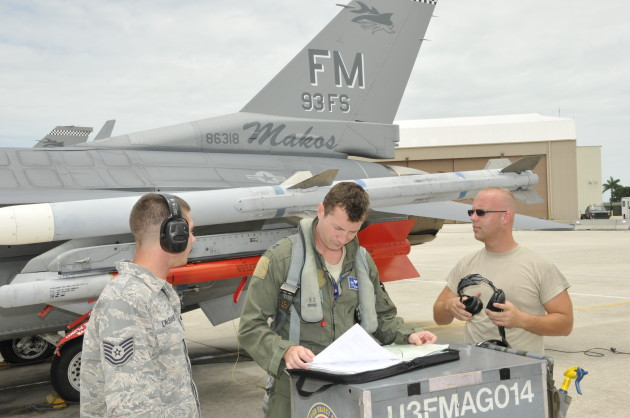 The author checks over the maintenance records for the 93 FS flagship prior to a training sortie at Homestead AFB, FL.