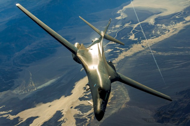A Rockwell (Boeing) B-1B Lancer equipped with the AN/AAQ-33 Sniper pulls off the tanker while en route to engage insurgent positions.