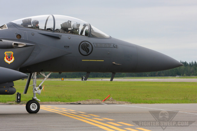 An F-15SG taxies into position on Eielson's runway. Notice the added sensor just above the intake.