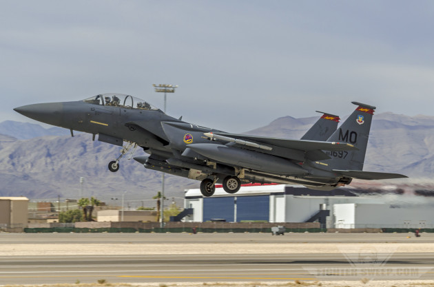 A Boeing F-15E Strike Eagle takes off from Nellis Air Force Base, Nevada during a Red Flag VUL in early 2012.