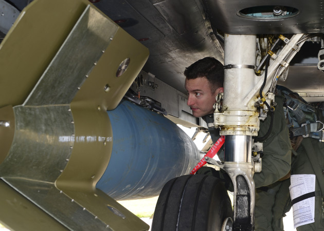 Colonel Novotny gets a closer look at a GBU-15 laser-guided bomb during his pre-flight for a training sortie. (Courtesy of 48th Fighter Wing Public Affairs)