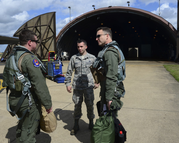 Colonel Novotny and his Weapons System Officer (WSO) talking briefly with their dedicated crew chief prior to mounting up for their training sortie. (Photo Courtesy of 48th Fighter Wing Public Affairs)