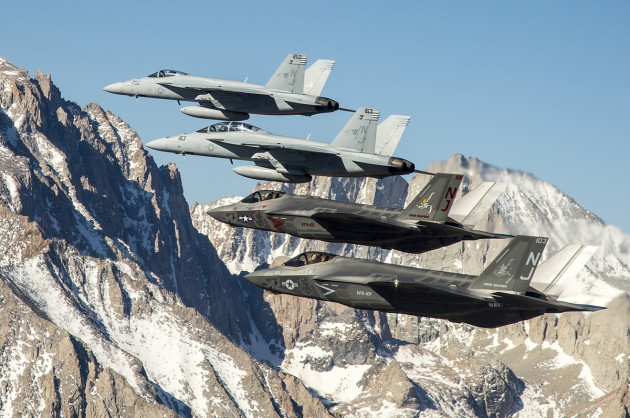 A pair of F-35C Lightning IIs fly in formation with F/A-18 Super Hornets from NAS Lemoore (U.S. Navy photo by Lt. Cmdr. Darin Russell/Released)