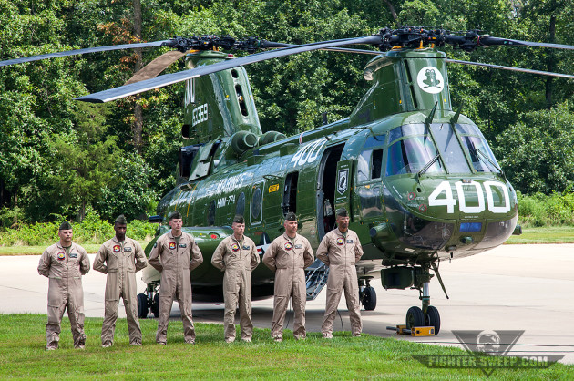 """A crew from HMM-774 """"Wild Goose"""" stands proudly in front of their CH-46E at the type's retirement ceremony"""