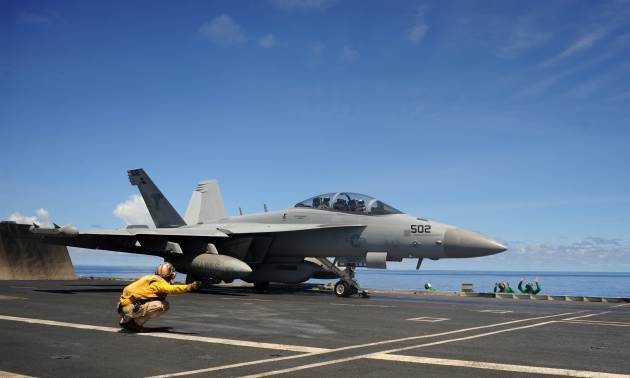 An E/A-18G Growler aircraft from the Shadowhawks of Electronic Attack Squadron (VAQ) 141 launches from the flight deck of the aircraft carrier USS George Washington (CVN 73). (U.S. Navy photo by Mass Communication Specialist Seaman Liam Kennedy/Released)