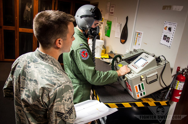 An AFE SrA and 1st LT of the 192FW check the continuity of an oxygen mask