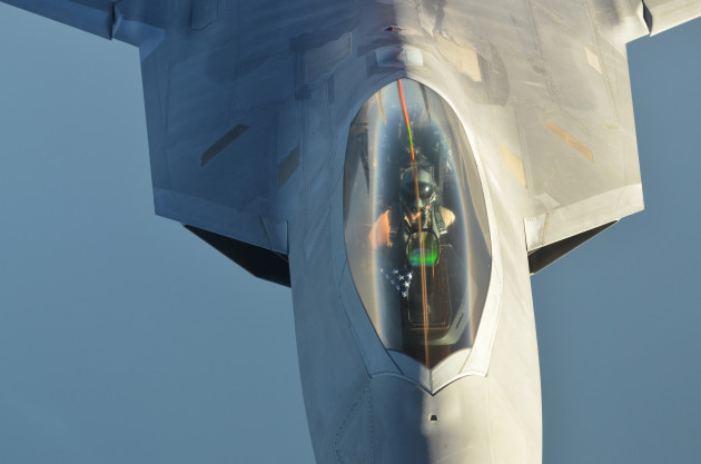 A U.S Air Force KC-10 Extender refuels an F-22 Raptor fighter aircraft after strike operations in Syria. (U.S. Air Force photo by Maj. Jefferson S. Heiland)