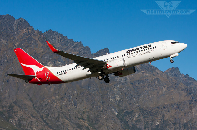 A Qantas Boeing 737 takes off from Queenstown, NZ
