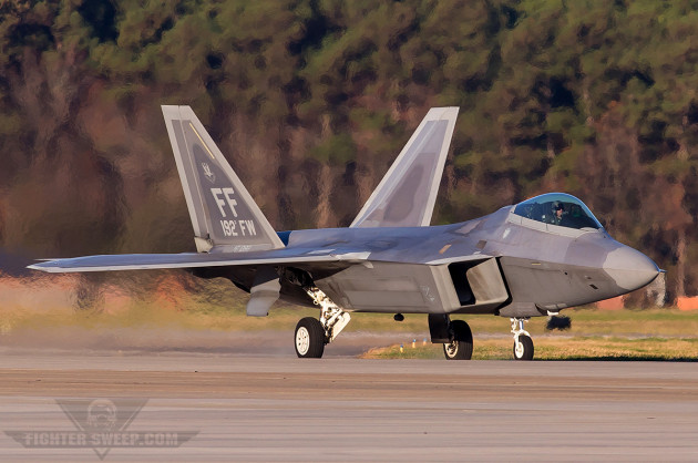 An F-22 Raptor marked for the 192nd Fighter Wing taxies back to the line after a morning airshow demonstration at JBLE (photo by Jonathan Derden)