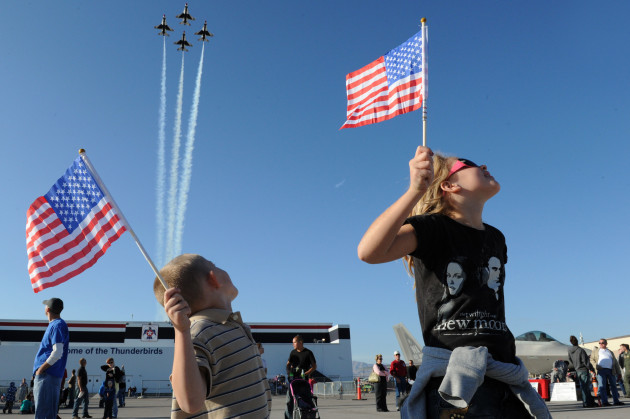 "Admiring young patriotic fans cheer on the U.S. Air Force Air Demonstration Squadron ""Thunderbirds"", as they perform the Diamond Opener during the Aviation Nation Air Show at Nellis Air Force Base, Nev., Nov. 12, 2011. (U.S. Air Force photo/Staff Sgt. Larry E. Reid Jr., Released)"
