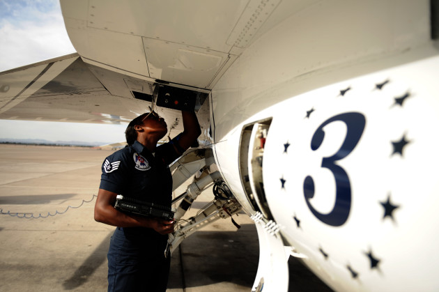 Staff Sgt. Tacota LeMuel, Thunderbird 3 dedicated crew chief, inspects the inside of a panel on her jet during a post-flight inspection at Nellis Air Force Base, Nev., March 12, 2012. (U.S. Air Force photo/Staff Sgt. Larry E. Reid Jr., Released)