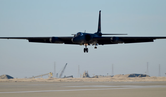 A U-2 Dragon Lady soars above the flightline at Beale Air Force Base, Calif., Jan. 22, 2014. The low-altitude handling characteristics of the aircraft and bicycle-type landing gear require precise control during landing. (U.S. Air Force photo by Airman 1st Class Bobby Cummings/Released)