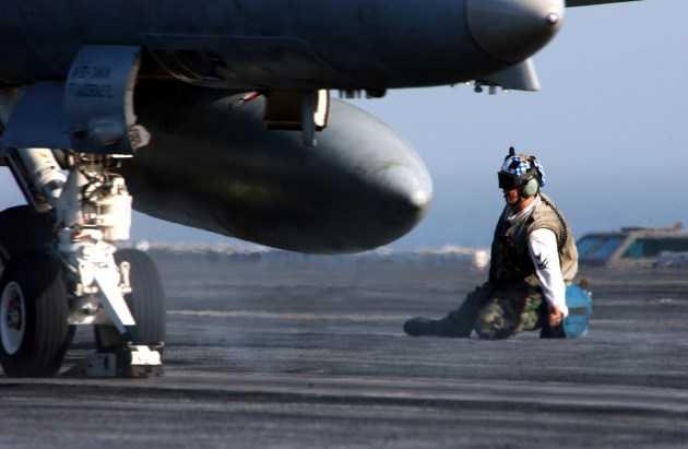 """A troubleshooter clears an F/A-18C Hornet assigned to the """"Blue Diamonds"""" of Strike Fighter Squadron One Four Six (VFA-146) for launch from one of four steam-driven catapults on board the Nimitz-class aircraft carrier USS Carl Vinson (CVN 70). U.S. Navy photo by Photographer's Mate 2nd Class Inez Lawson (RELEASED)"""
