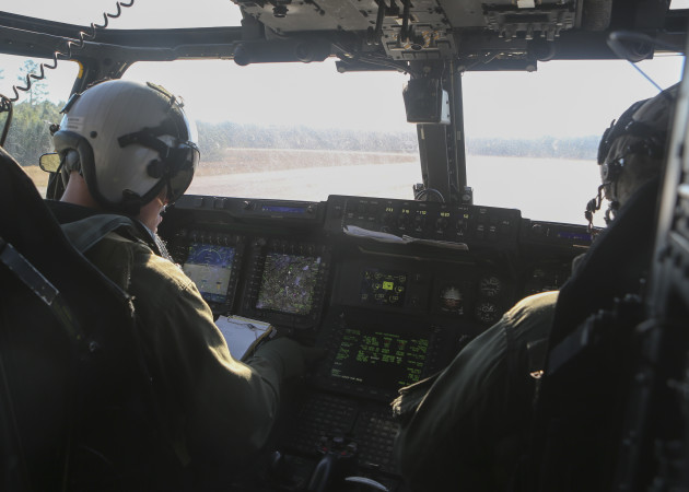 1st Lt. Erik Erlandson (left) completes the pre-flight checklist aboard the MV-22B Osprey while his evaluator, Maj. Matthew Cave oversees his work prior to take-off of his final flight with Marine Medium Tiltrotor Training Squadron 204 at Marine Corps Air Station New River, N.C., Jan. 12, 2016. Erlandson underwent four months of intensive flight training on the MV-22B to ensure he could meet all the standards required of Marine Corps pilots in the operating forces. (U.S. Marine Corps photo by Cpl. Michelle Reif/ Released.)