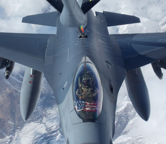 An F-16 pilot from the 482nd FW flies an American Flag over the snowy mountains of Afghanistan in early 2015. (Photo courtesy of Scott Wolff)