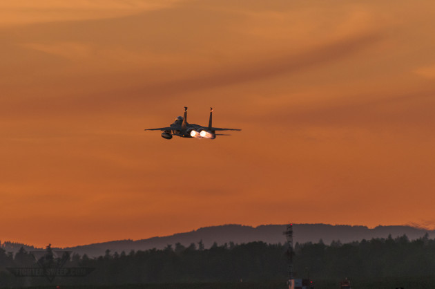 """Colonel Adam """"Kahn"""" Sitler takes off into an Oregon sunset, en route to the coast for a night training mission. (Photo by Scott Wolff)"""