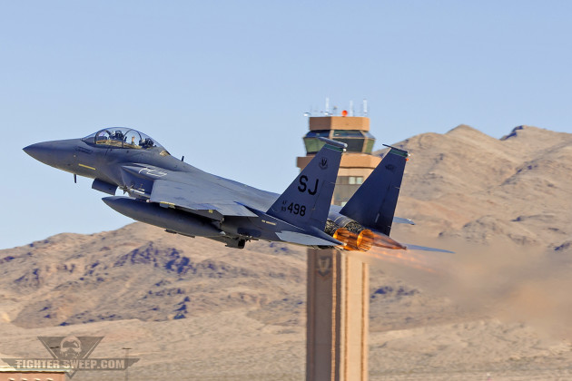 A McDonnell Douglas F-15E Strike Eagle from the 335th Fighter Squadron at Seymour Johnson AFB in North Carolina departs Nellis on a Red Flag mission. (Photo by Scott Wolff)