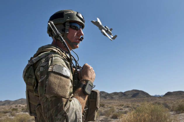 A JointTerminal Attack Controller uses a radio to communicate with pilots of A-10 Thunderbolt II aircraft during a close air support training mission at the Nevada Test and Training Range. USAF photo by Tech. Sgt. Michael R. Holzworth, U.S. Air Force. (Released)