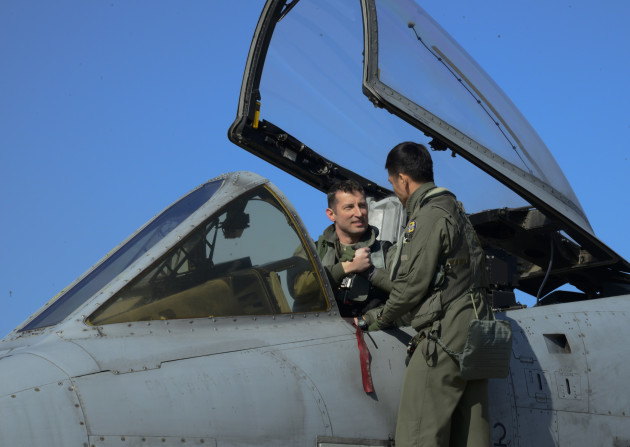 U.S. Air Force Col. Andrew Hansen, 51st Fighter Wing commander discusses the KA-1 Woongbi fighter aircraft with Republic of Korea air force Capt. Ahn, Hae-Chul, 237th Fighter Squadron pilot, during Buddy Wing 16-2 on Osan Air Base, ROK, Feb. 22, 2016. The exercise provides an opportunity for the allied forces to train together and strengthen tactics in the event of real-world contingencies. (U.S. Air Force photo by Senior Airman Kristin High/Released)