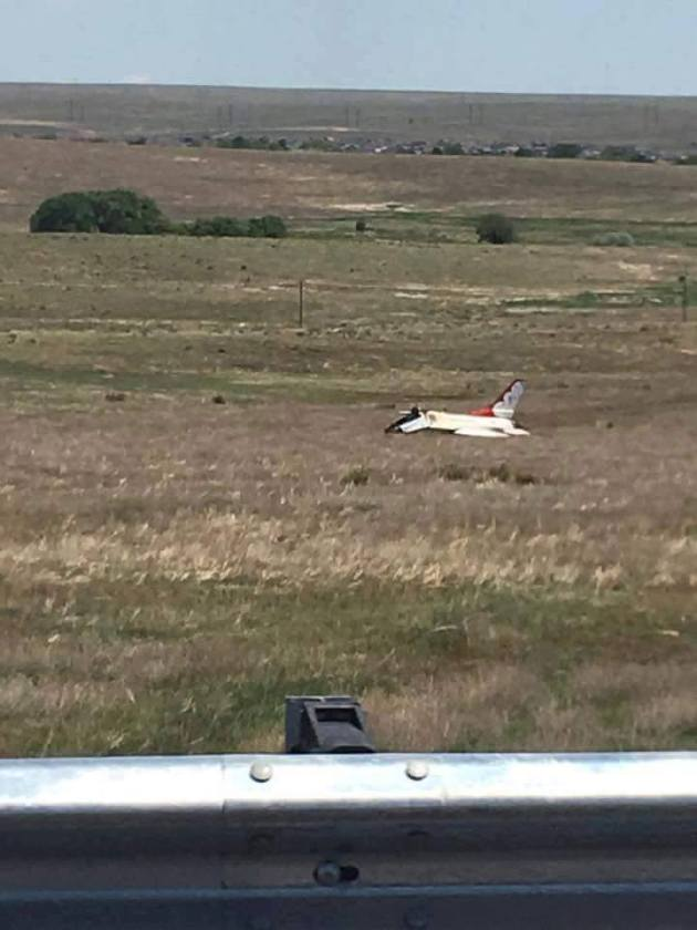 Thunderbird #6 rests in a field near Colorado Springs after pilot Maj Alex Turner ejected (photo courtesy Travis Rock)