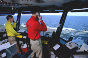 The ships Air Boss and Mini-Boss control all aircraft operations on the flight deck. U.S. Navy photo Photographer Mate 2nd Class James Watson (Released)