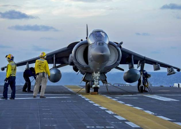 (June 27, 2016) Sailors secure an AV-8B Harrier on the flight deck of the amphibious assault ship USS Wasp (LHD 1). Wasp is deployed with the Wasp Amphibious Ready Group to support maritime security operations and theater security cooperation efforts in the U.S. 5th and 6th Fleet areas of operation. (U.S. Navy photo by Mass Communication Specialist 3rd Class Michael Molina/Released)