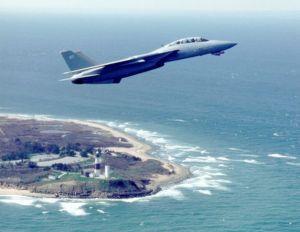 An F-14D over Montauk Lighthouse (Grummanpark.org)