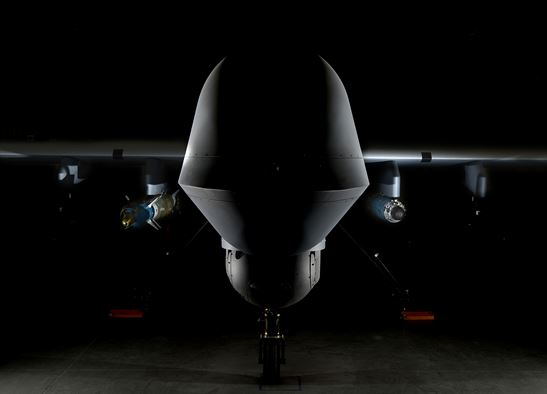 MQ-9 Reaper is loaded with a GBU-12 laser-guided bomb on the left and a GBU-38 Joint Direct Attack Munition