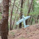 A small aircraft what South Korea's Military said is believed to be a North Korean drone, is seen at a mountain near the demilitarized zone separating the two Koreas in Inje