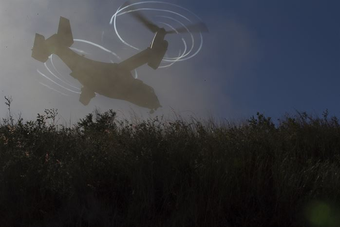 MV-22B Osprey tiltrotor aircraft lifts off from a hilltop during Exercise Talisman Saber 17 on Townshend Island Shoalwater Bay Training Area Queensland Australia