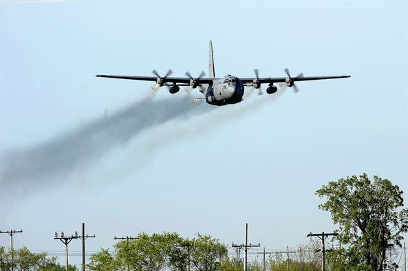 An Air Force Reserve aircrew flying a C-130 Hercules assigned to the 910th Airlift Wing, Youngstown perform a mosquito control aerial spray mission