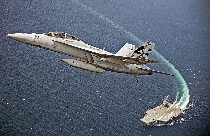 F-A-18F_Super_Hornet_flies_over_the_USS_Gerald_R._Ford