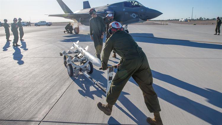 Marine Fighter Attack Squadron 121 load ordnance on a F-35B Lightning II