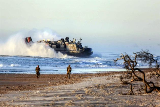 Navy air-cushioned landing craft head to shore at Marine Corps Base Camp Lejeune