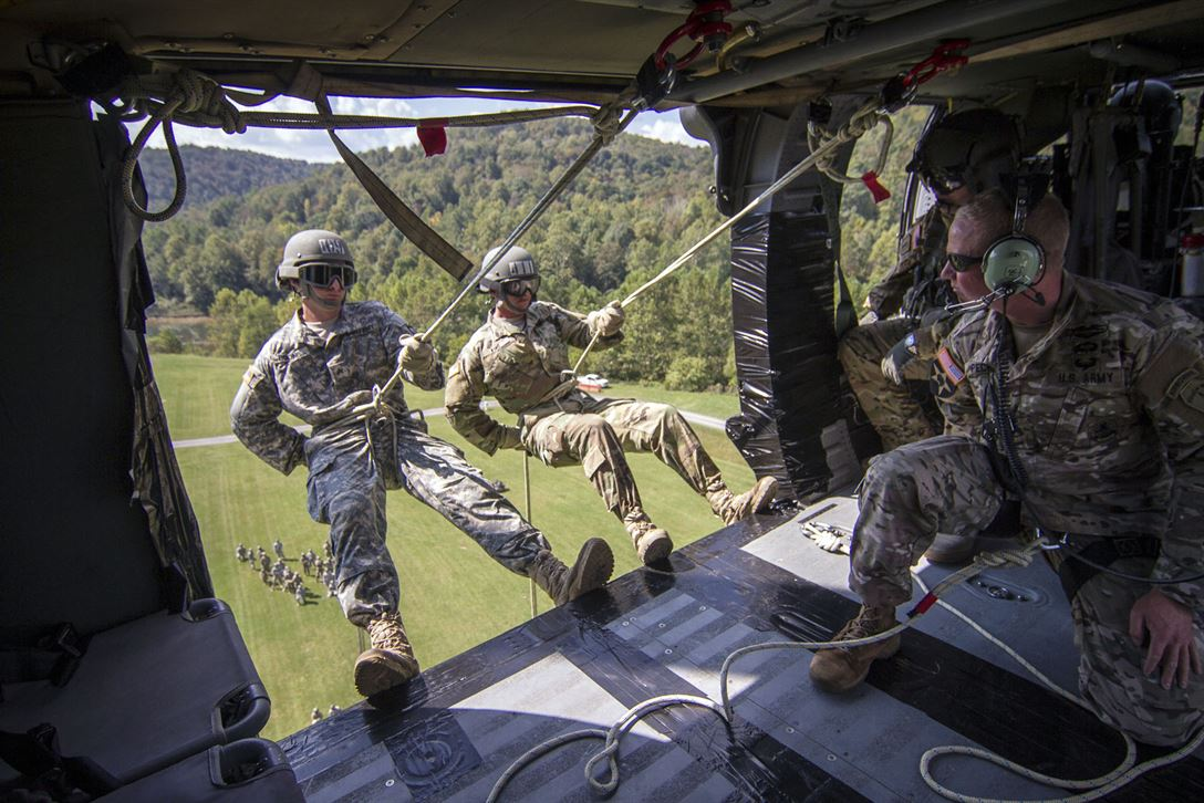 Soldiers prepare to rappel from a UH-60 Black Hawk helicopter
