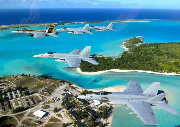 VFA-27 Royal Maces a United States Navy FA-18E Super Hornet squadron based in Atsugi Japan flies over the Downtown area of Wake Island