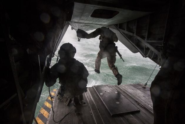 military student from a team leaders course jumps from the back of a CH-53E Super Stallion helicopter