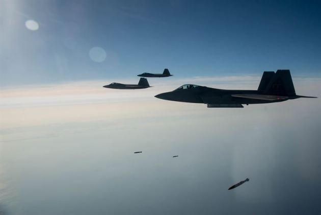 94th Fighter Squadron F-22A Raptor pilots drop Joint Direct Attack Munitions
