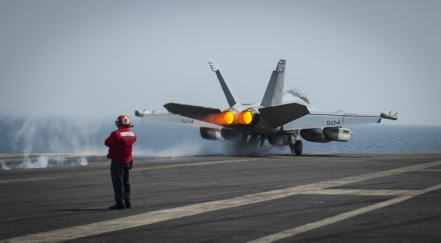 EA-18G Growler assigned to the Cougars of Electronic Attack Squadron (VAQ) 139 launches from the flight deck of the aircraft carrier USS Carl Vinson