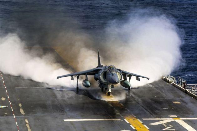 Marine Corps AV-8B Harrier with Marine Medium Tiltrotor Squadron 162, 26th Marine Expeditionary Unit, takes off